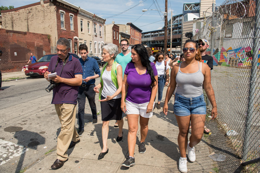 Cheri Honkola (center, right) leads Jill Stein (center, left) through the streets of Kensington for a reality tour./Natalie Piserchio