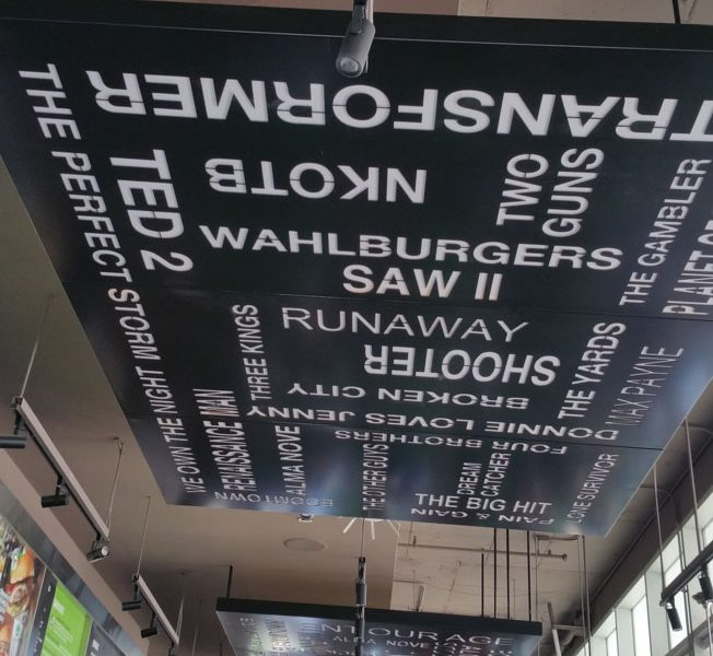 Ceiling fixture displaying names of Mark Wahlberg films. /Michael Antonion Castaneda