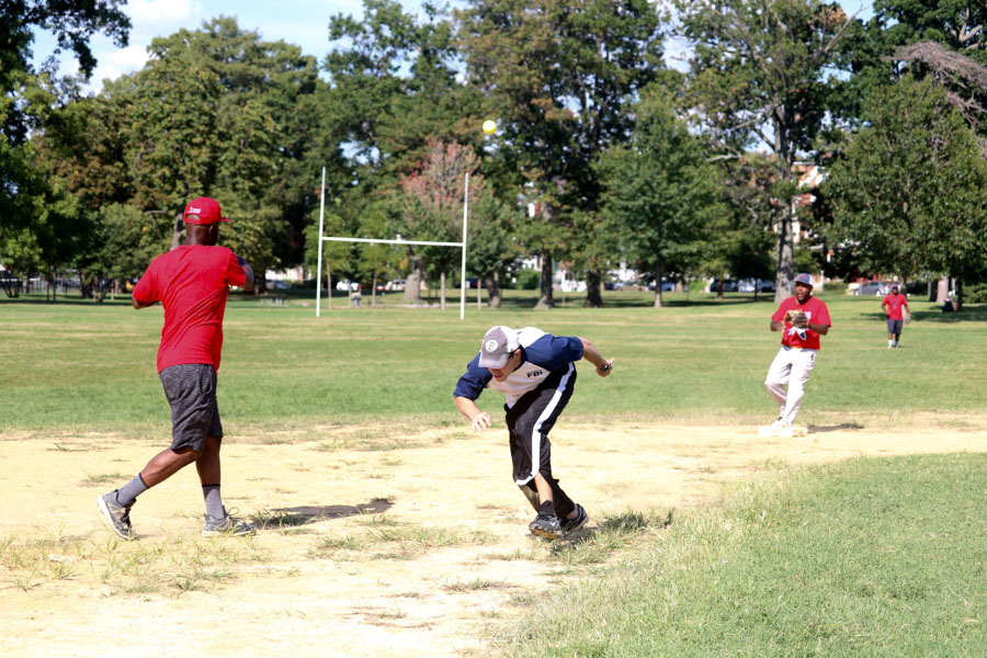FBI player, Daron, runs for third base during the 10th annual Step Up to the Plate: Strike Out Violence softball game. /Kaitlyn Moore