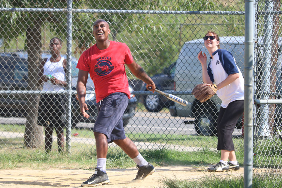 Strawberry Mansion teammate, Brandon Mundy looks on at his hit during the 10th annual Step Up to the Plate: Strike Out Violence softball game. /Kaitlyn Moore