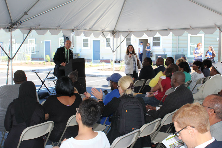 Councilman Mark Squilla addresses the crowd to commemorate the ribbon cutting of Grace Townhomes.