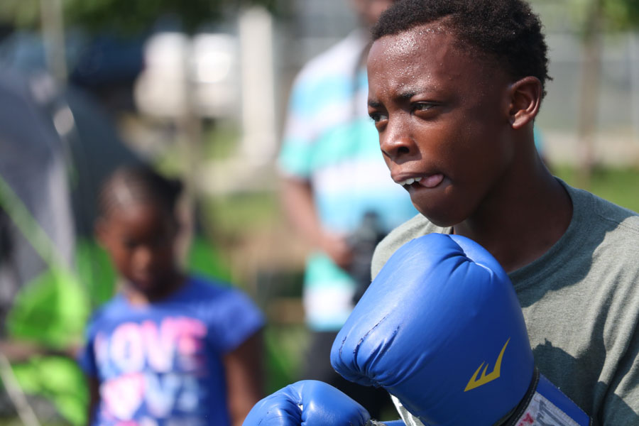 2020 Olympic hopeful, Isaiah Johnson of ABC boxing gym performs with his assistant coach, James Lyons, during the annual Strawberry Mansion Day festival.