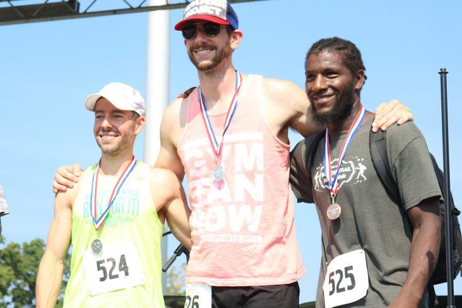 The top three men's division winners of the fifth annual Boxers' Trail 5k pose for a photo.