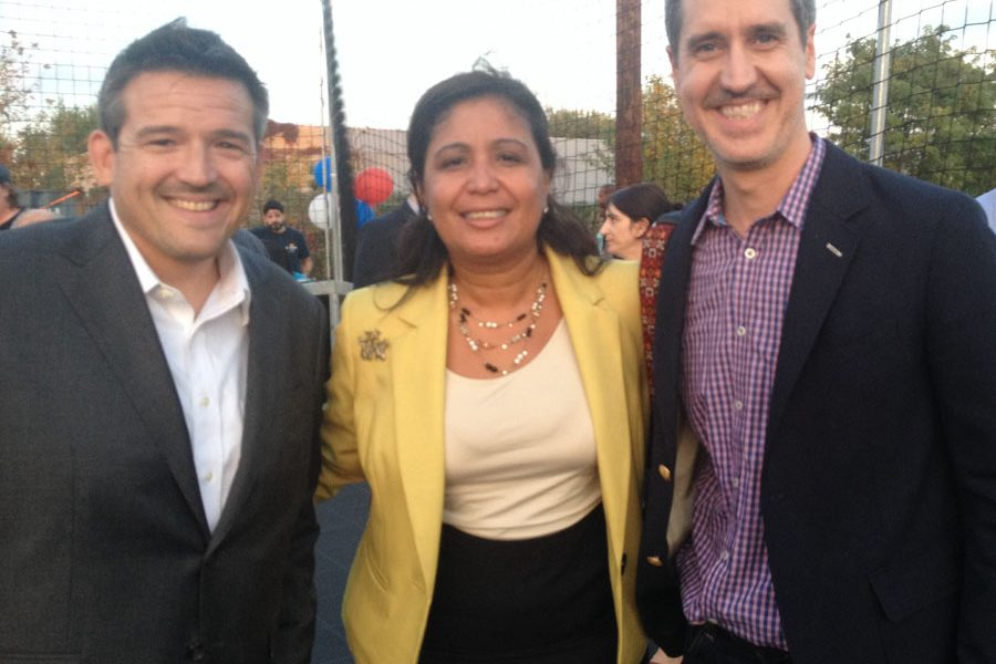 Casey O'Donnell - executive director of Impact Services CDC celebrates with Councilwoman Maria D. Quiñones-Sánchez and Brian Murray, Shift Capital Principal & CEO