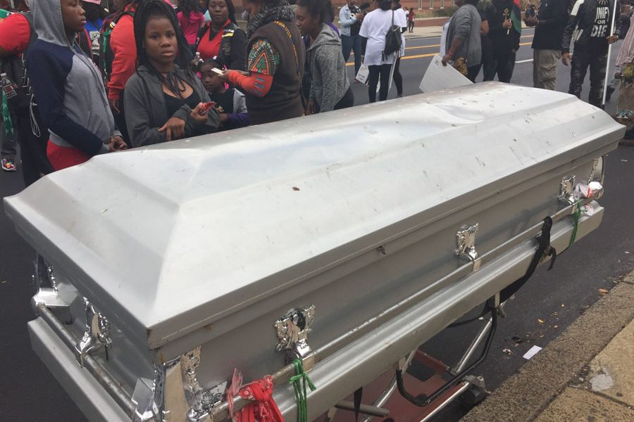 An empty coffin represented the men and women lost to gun violence, and it symbolized the vision the communities have to no longer see such senseless violence happen.