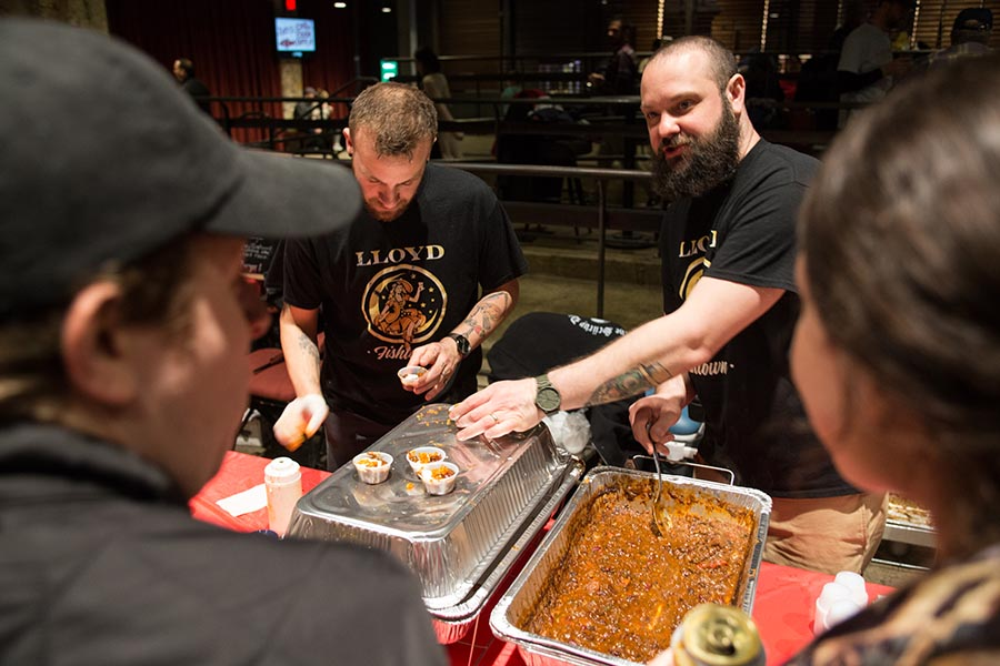 The chili chefs of Lloyd Whiskey Bar distribute their braised beef cheek chili with a ranch and goat cheese crema and barbecued pork rinds at the 2017 FNA Chili Cook Off. /Patrick Clark