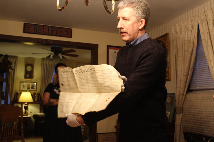 Jim Duffin, archivist for UPenn shows the group the inside of one of the deeds.