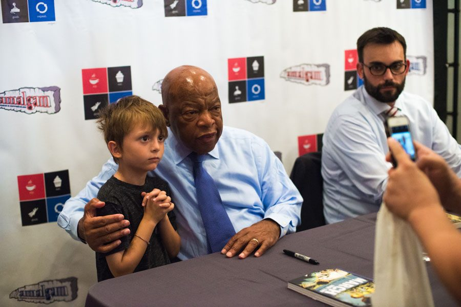 Lewis poses with a child after signing his book./Jordyn Cordner