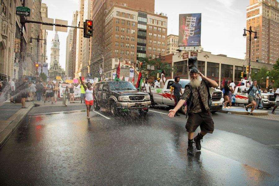 Vermin Supreme dances down Broad Street. He considers himself a presidential candidate./Natalie Piserchio