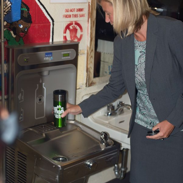 Fran Burns uses one of the new hydration stations at H.A. Brown School.