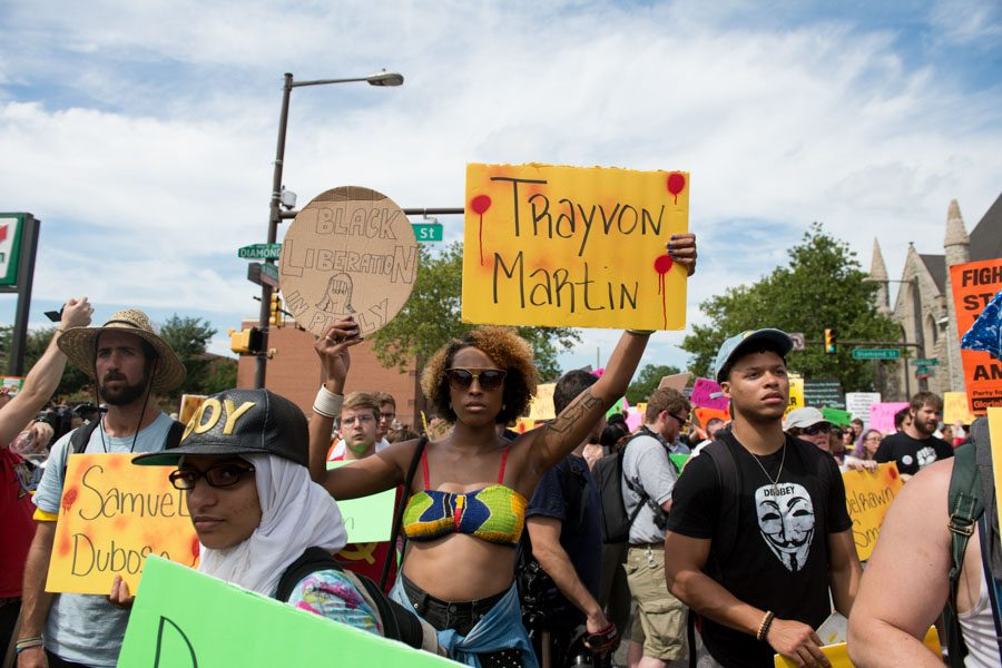 Demonstrators carry signs bearing the names of those killed by police or armed citizens in the Coalition For REAL Justice's march./Natalie Piserchio