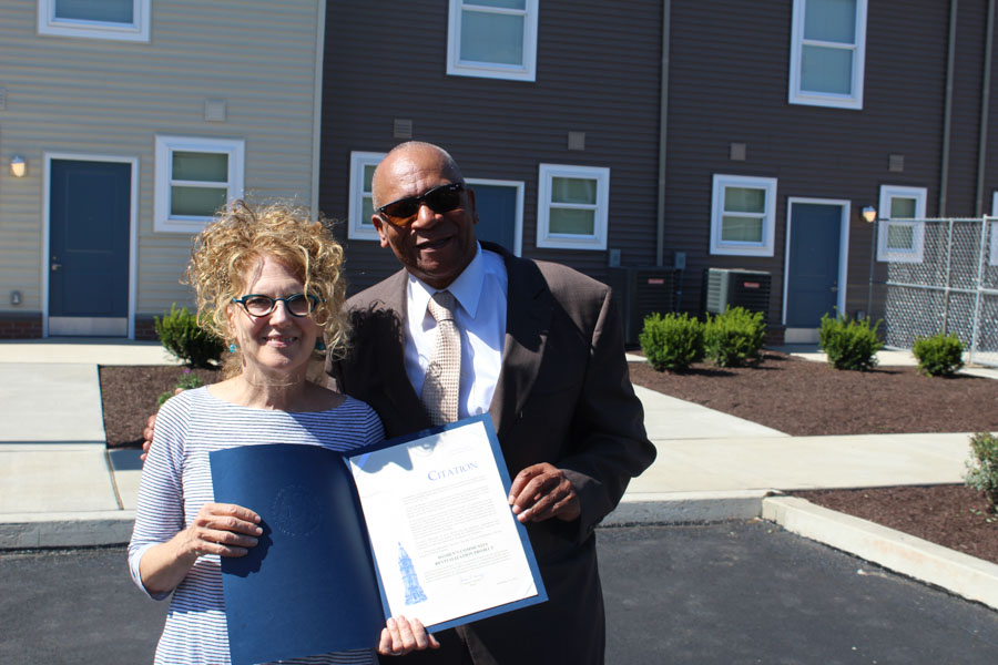 Nora Lichtash (left), Executive Director of the Women's Community Revitalization Project, and Richard Harris (right), Pastor at Firm Hope Baptist Church holding Philadelphia Mayor Jim Kenney's citation celebrating the Grace Townhomes ribbon cutting.