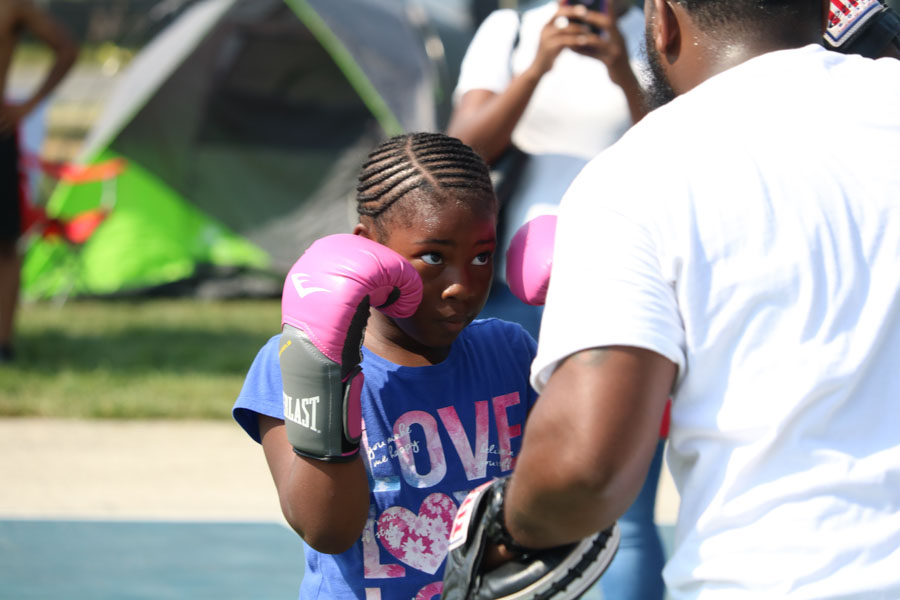 Lauren Smith spars with James Lyons during Strawberry Mansion day.