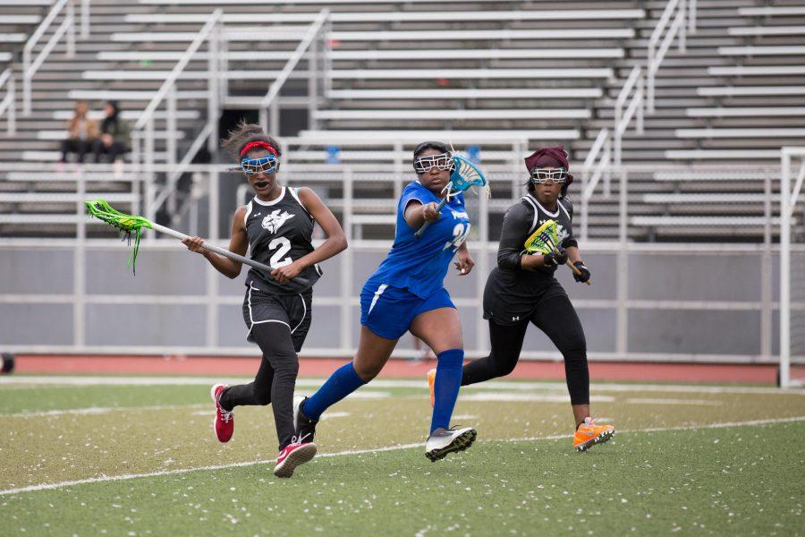 "Nadirah ""Na"" Gateword cradles the ball as she advances towards to opposing goal. /Patrick Clark"