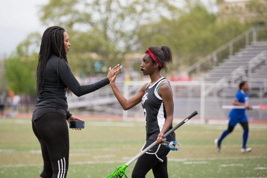 "Jasmine A. Smith high fives Nadirah ""Na"" Gateword following a stoppage of play. /Patrick Clark"