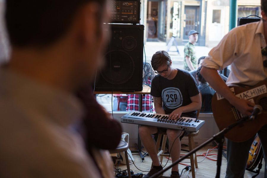 Mike Wambolt, one of the owners of Crime and Punishment, plays keys at the June First Friday event. /Patrick Clark