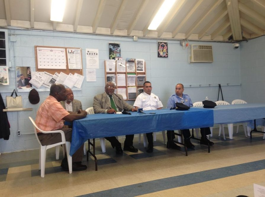Representative Thomas and other community leaders discuss the gun violence epidemic.